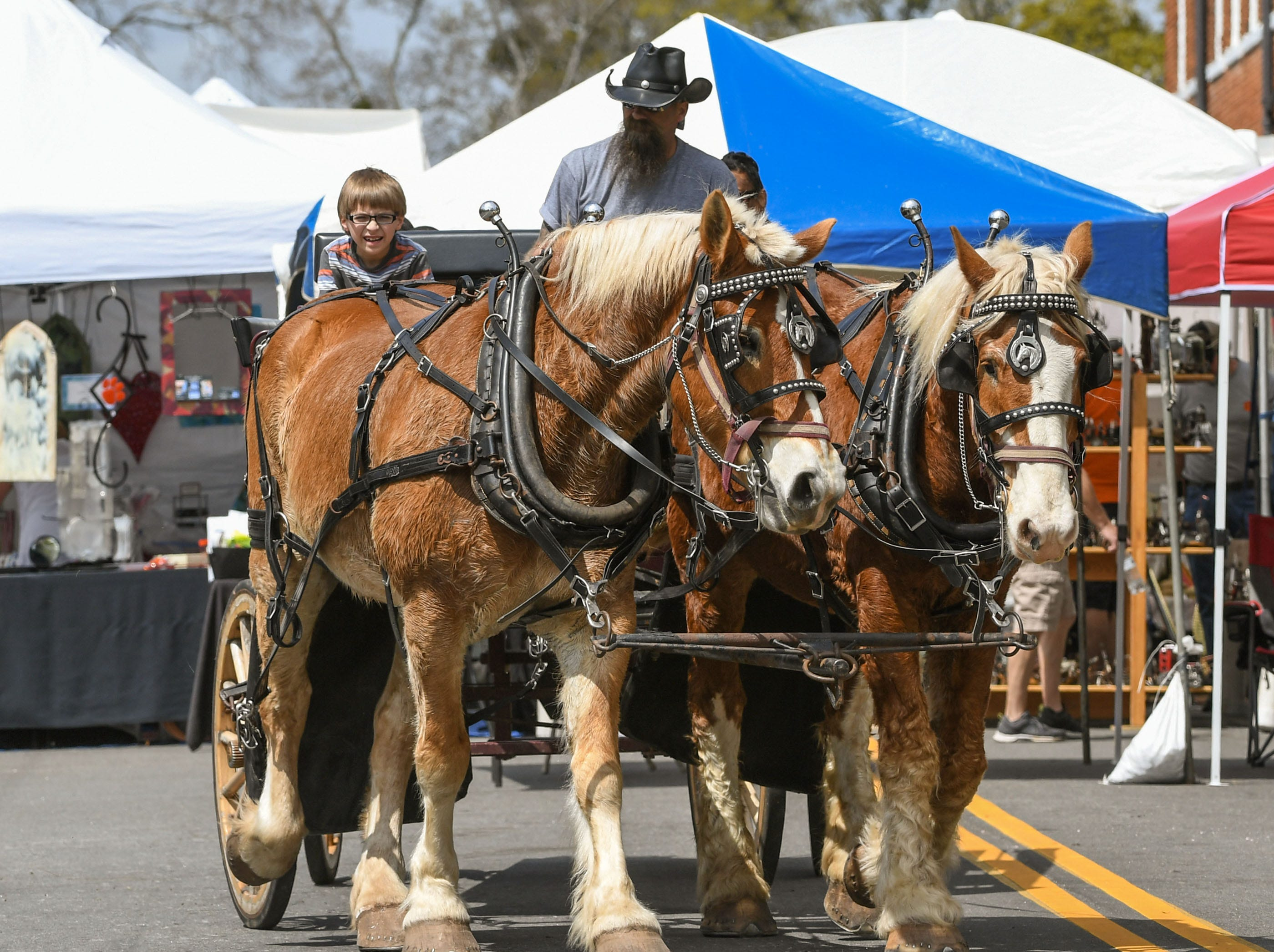 Horse and buggy riders make a trip around downtown during the Spring Jubilee in Historic Pendleton Saturday.
