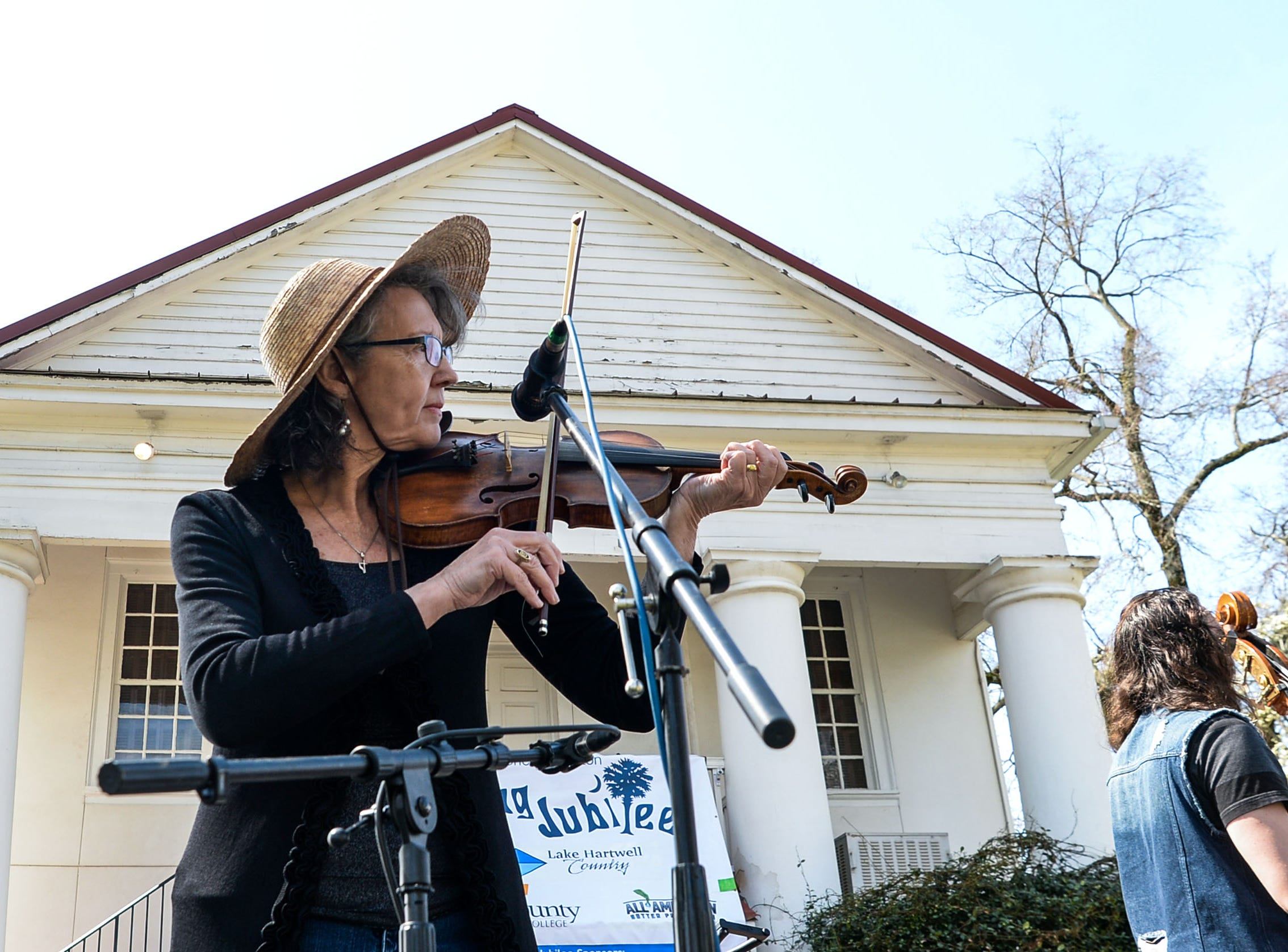 Lynn Martin of Conservation Theory plays during the Spring Jubilee in Historic Pendleton Saturday.
