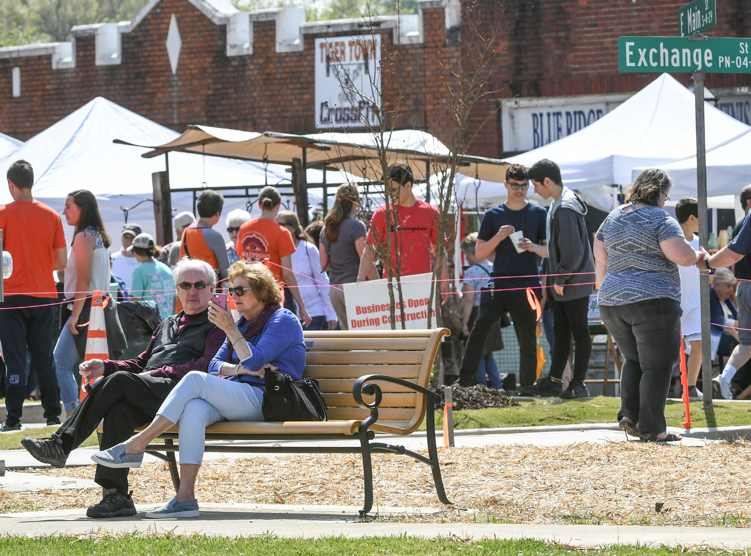 People walk around and sit around artist and food booths during the Spring Jubilee in Historic Pendleton Saturday.