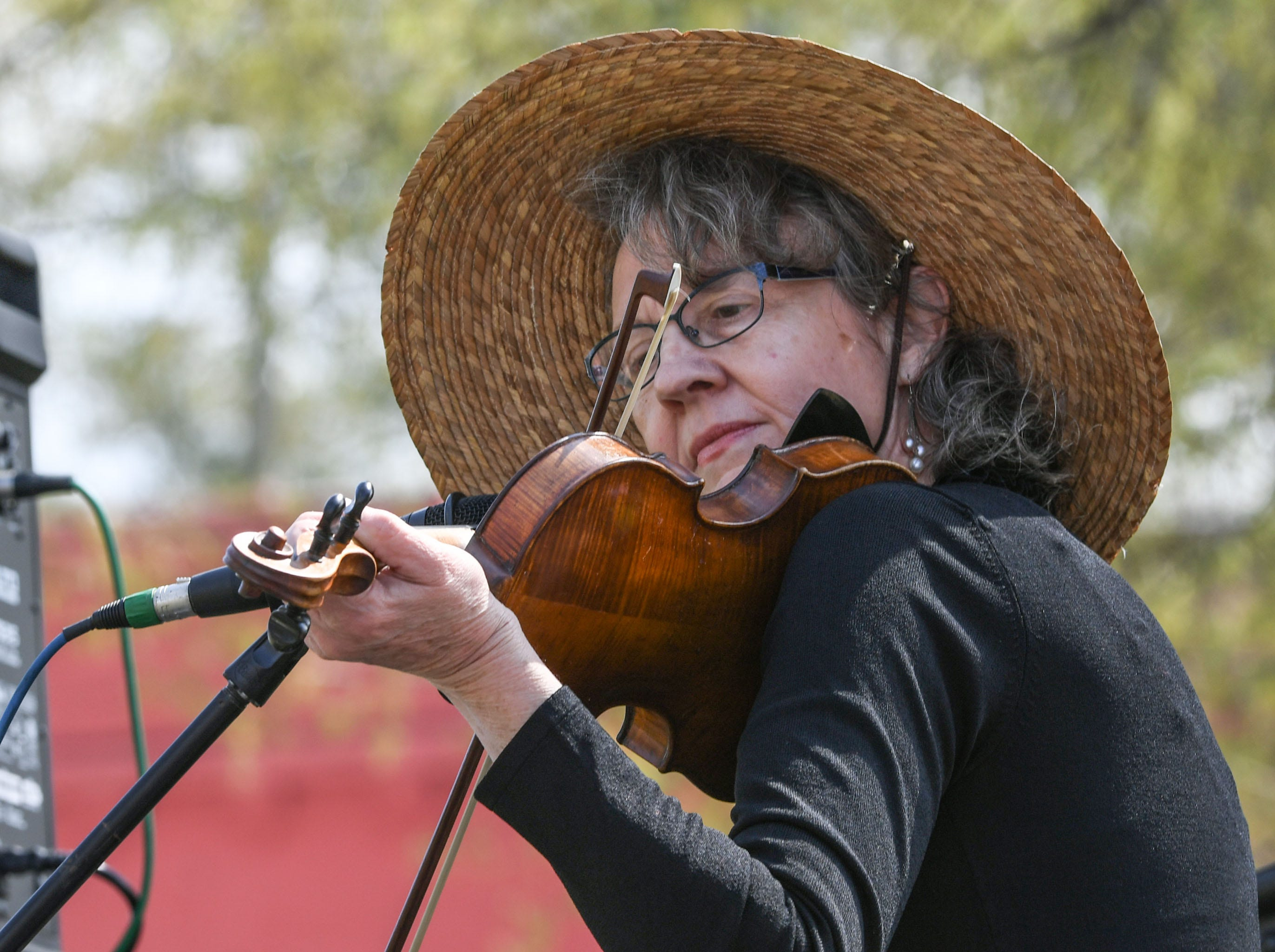 Lynn Martin of Conservation Theory bluegrass band plays a fiddle during the Spring Jubilee in Historic Pendleton Saturday.