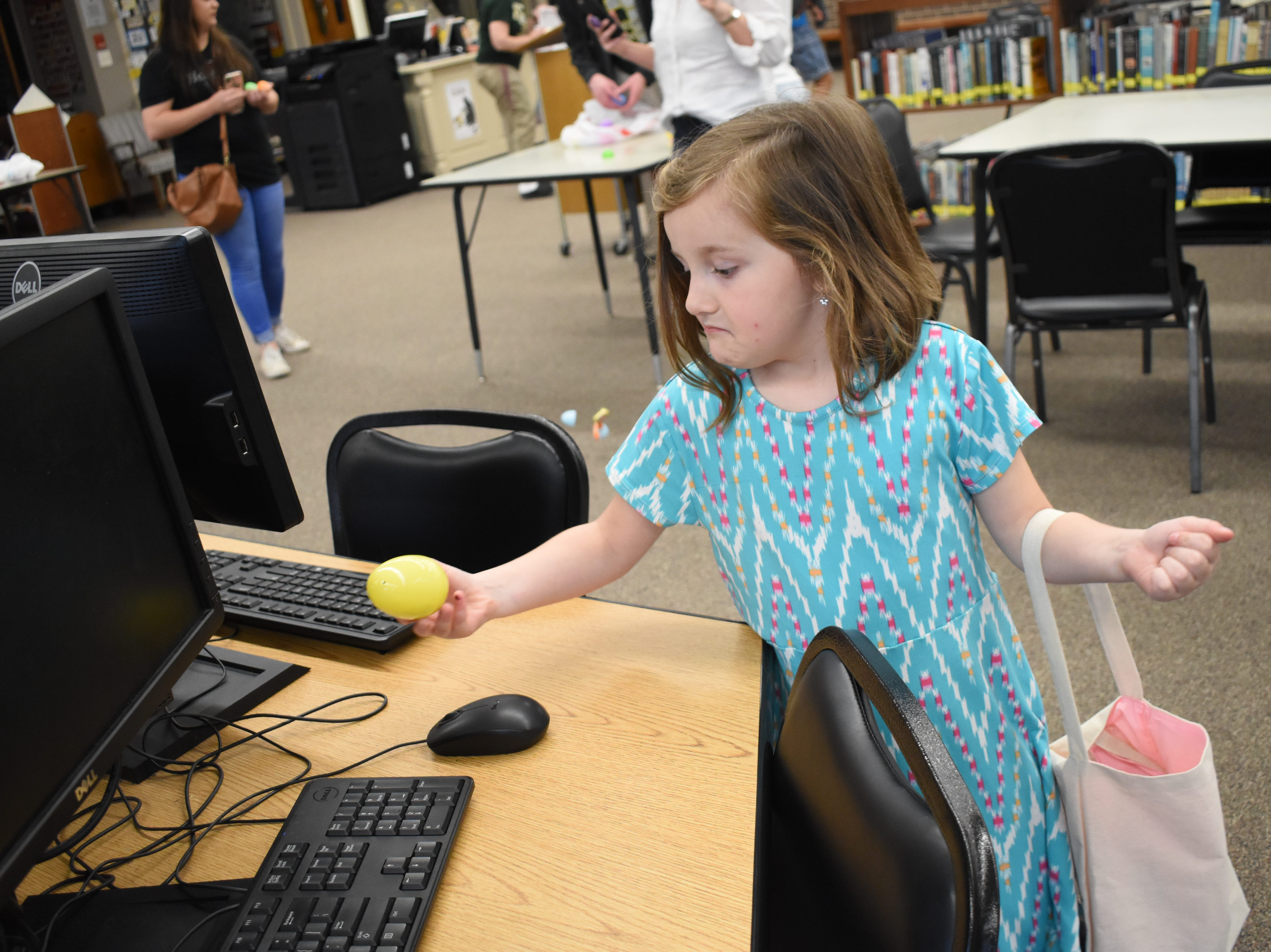 """The Beta Club of Holy Savior Menard High School hosted Easter at the Nest Saturday, April 6, 2019. Matthew Dufrene, a senior and president of the Beta Club, said this was the second year for the event held for children ages 2-10. An Easter egg hunt was held in the library and other activities included egg dying, coloring, a Peep toss and egg toss. Dufrene said the numbers 1,2 and 3 were hidden in some plastic eggs. Those numbers would win some children a chocolate Easter bunny prize. The numbers corresponded to the size of the chocolate bunny with """"1"""" being the biggest."""