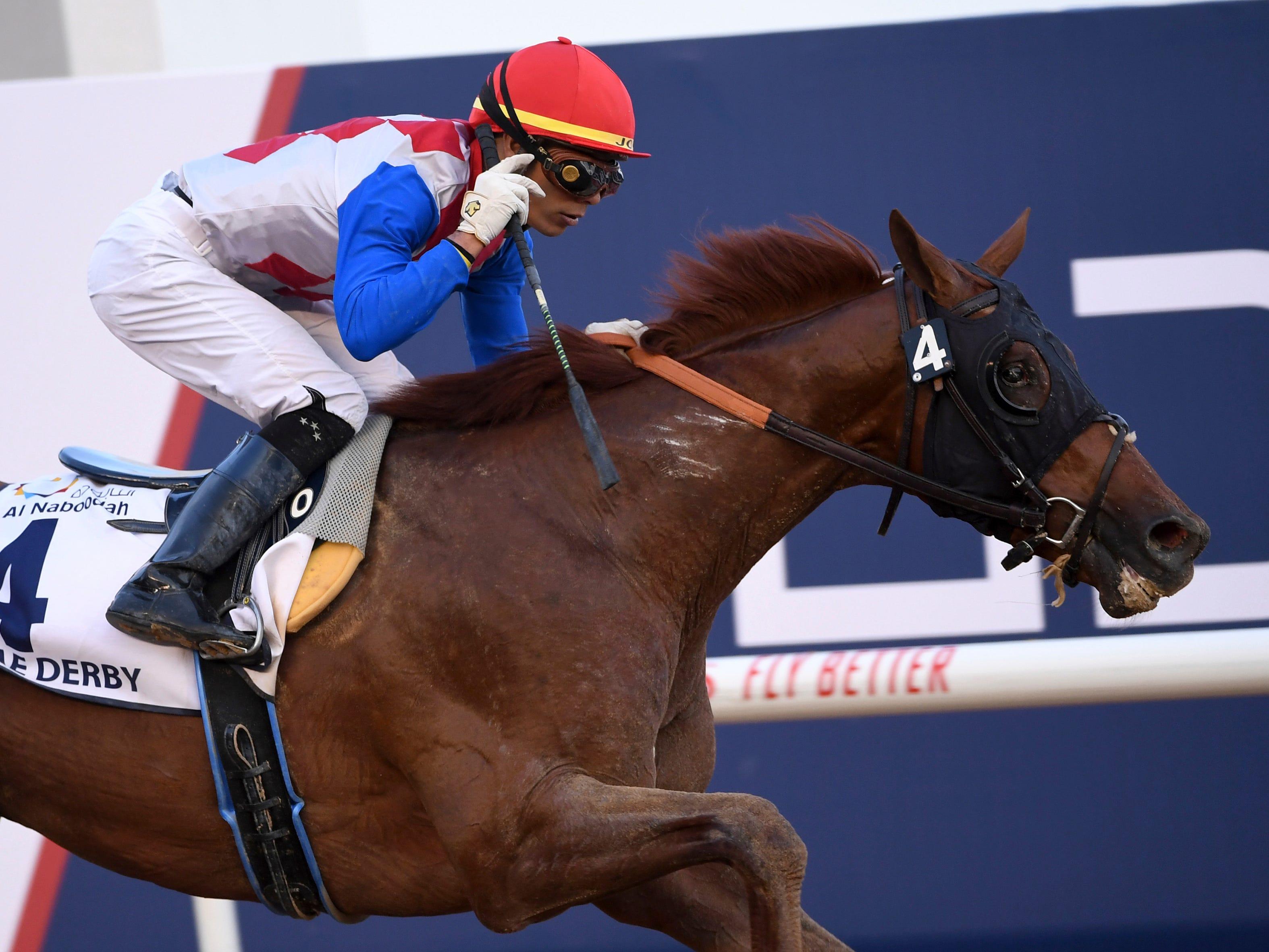 Plus Que Parfait, with jockey Jose Ortiz ,wins the $2.5 million Group 2 UAE Derby in Dubai, United Arab Emirates, Saturday, March 30, 2019.