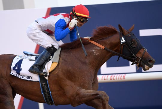 Plus Que Parfait, with jockey Jose Ortiz ,wins the $2.5 million Group 2 UAE Derby in Dubai, United Arab Emirates, Saturday, March 30, 2019.