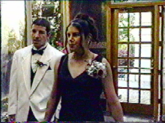 Melissa Drexler arrives with her boyfriend John Lewis at the Lacey High School Prom at the Garden Manor in Aberdeen on Friday, June 6, 1997, as seen in this video still from Lacey High School's WLTS. A short time later she gave birth in the rest room to a baby boy, and later admitted to killing him.