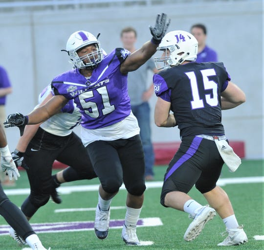 ACU defensive tackle Michael Gayden (51) closes in for the sack on quarterback Cole Klayman during the Wildcats' spring game Friday, April 5, 2019, at Wildcat Stadium.