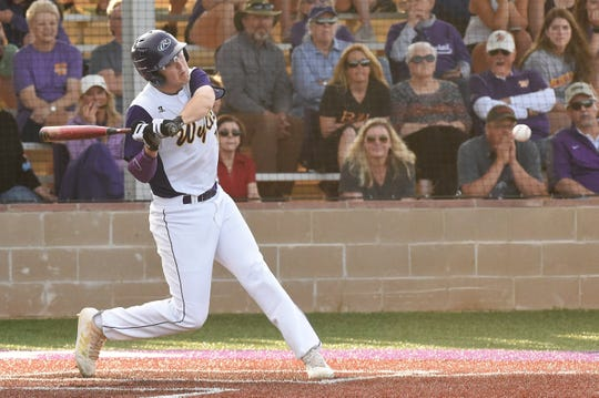 Wylie's Kanon Doby (17) swings to hit an RBI double in the sixth against Aledo. The Bulldogs scored single runs in the fifth and sixth to help hold off Aledo's comeback bid.