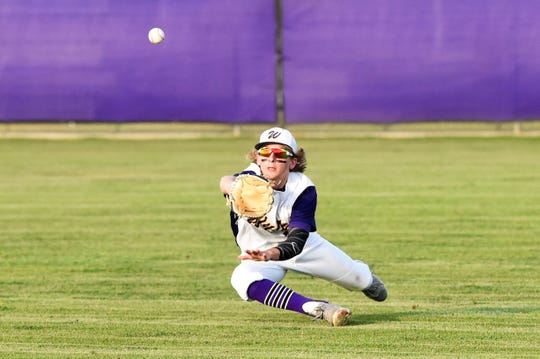 Wylie right fielder Cooper Cothran (21) starts to dive for the ball against Aledo during the 2019 season. Cothran is part of a large, experienced junior class for the Bulldogs this season.
