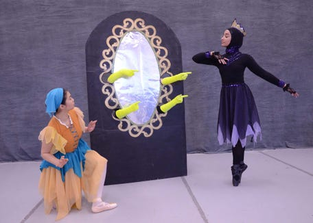 "The Queen (MacKenzie Shorter, right) gets her daily affirmation from the Magic Mirror as Snow White (Christina Calma) watches in Dance Arts Theatre's production of ""Snow White,"" which has performances April 13 and 14 at the Bremerton Performing Arts Center."
