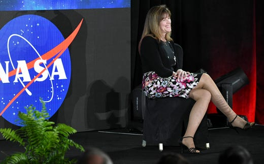 Janet L. Kavandi, US President of the Hall of Fame, laughs at a joke Steven Lindsey shared during Saturday's ceremony at the Kennedy Space Center Visitor Complex.