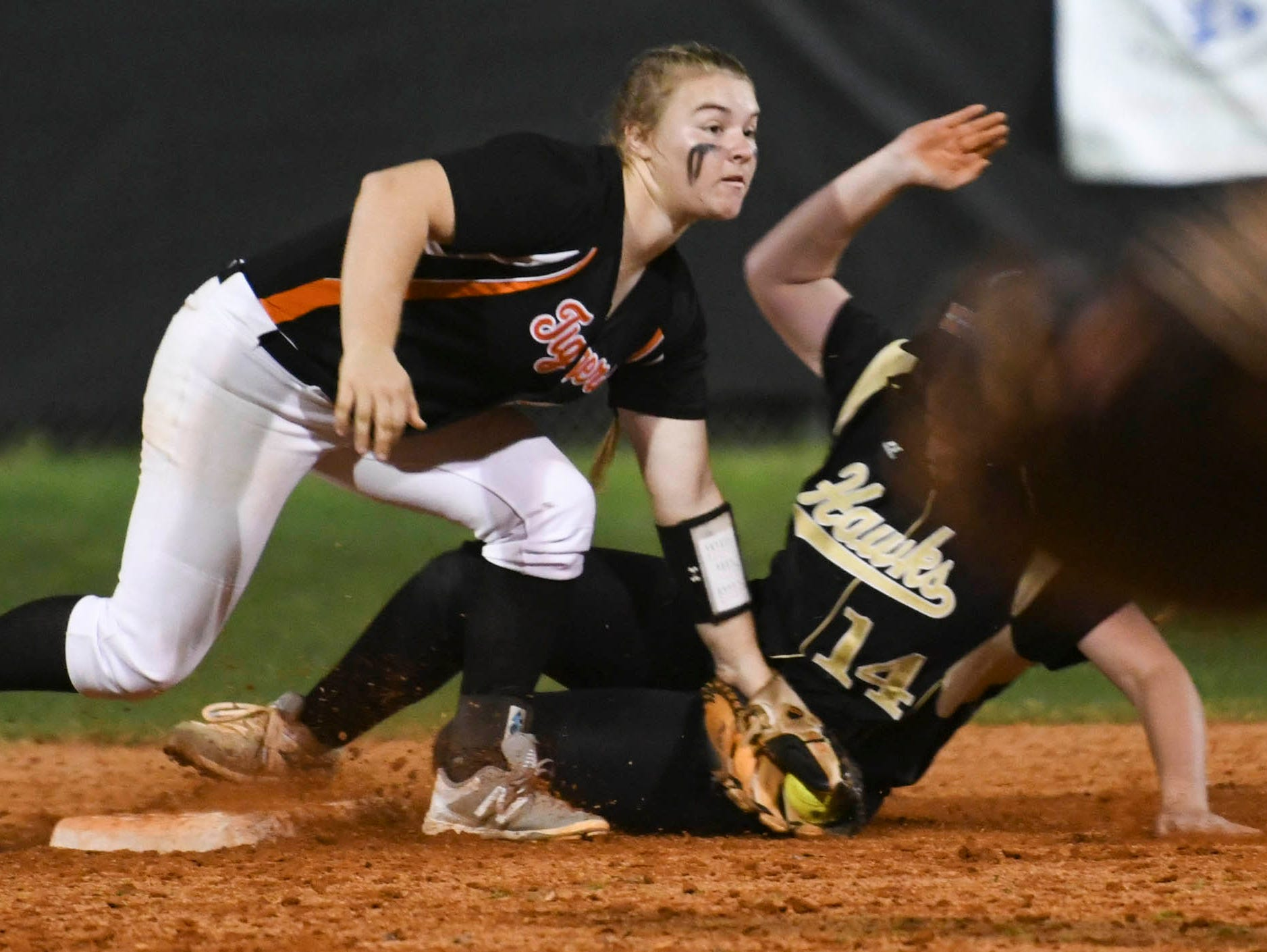 Cocoa's Mackenzie Hoffman tags out Viera baserunner Anna Brait to complete the double play during Friday's game.