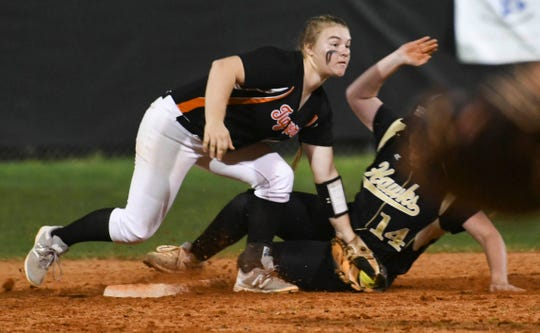 Cocoa's Mackenzie Hoffman tags out a Viera baserunner in a 2019 game.