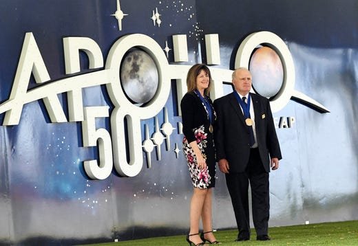 James F. Buchli and Janet L. Kavandi, representatives of the US Astronaut Hall of Fame, stand in for pictures at the Kennedy Space Center Visitor Complex on Saturday.