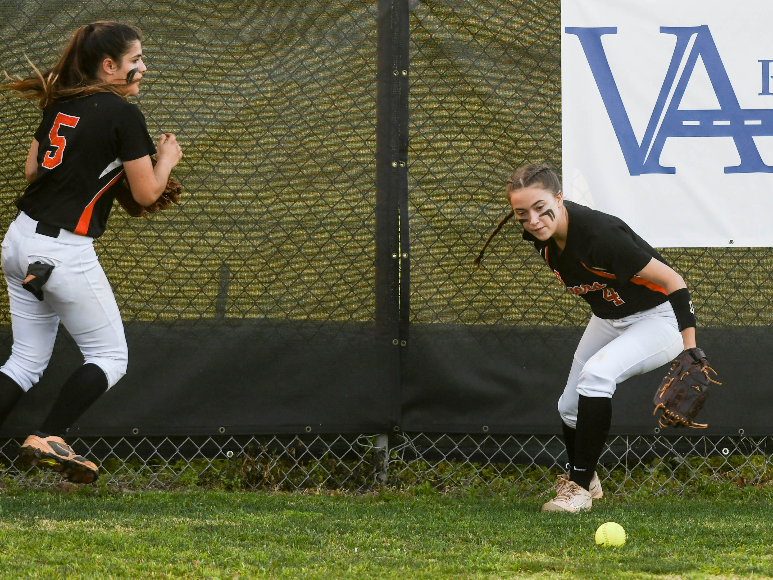 Cocoa's Trinity Choron (4) and Kara Rogers (5) track down a ball the fence during Friday's game against Viera.