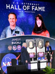 US Astronaut Hall of Fame inductees James F. Buchli and Janet L. Kavandi are introduced to the crowd during ceremonies Saturday at Kennedy Space Center Visitor Complex.