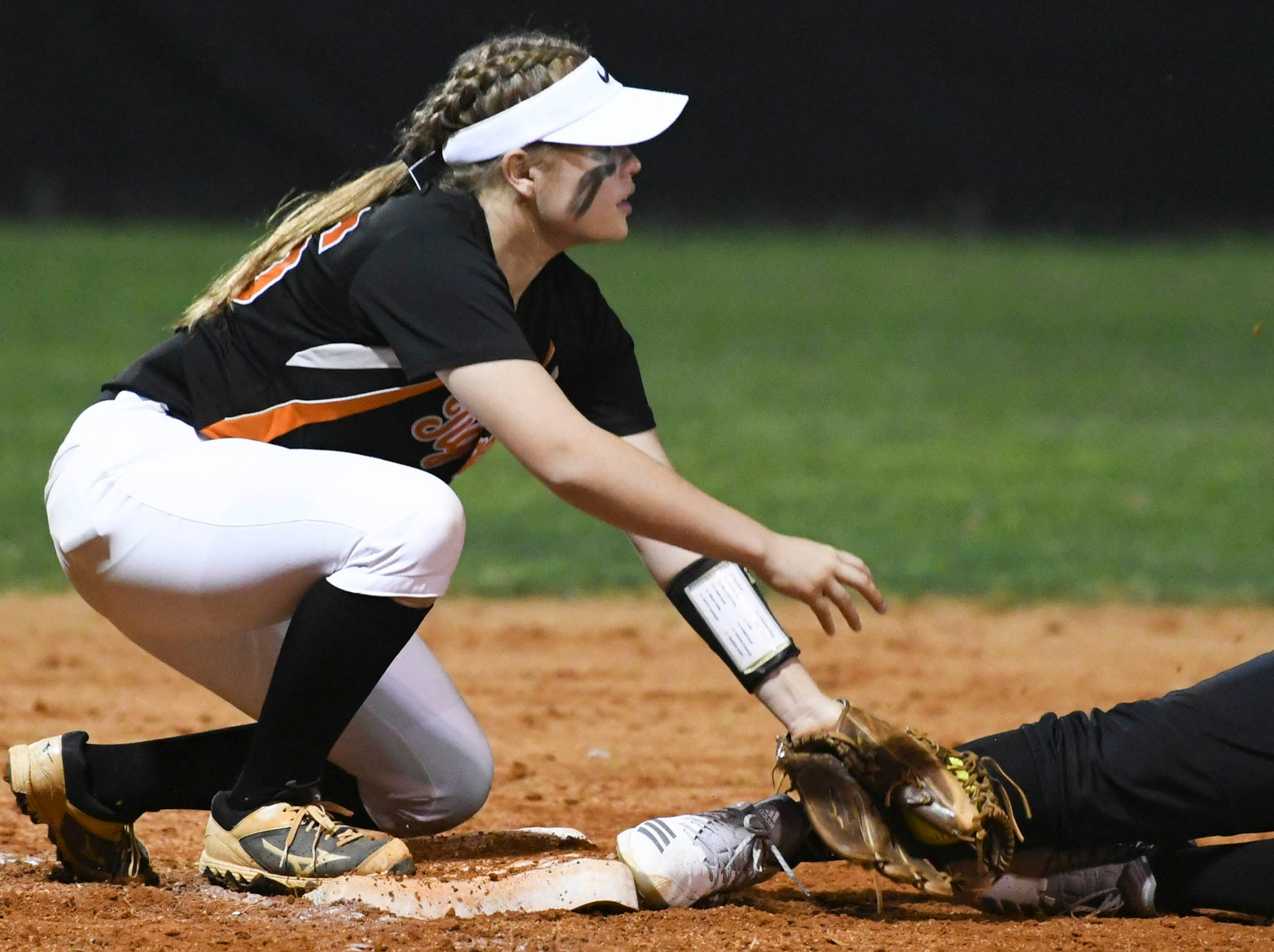 Cocoa's Sara Beth Smith tags out a Viera baserunner during Friday's game.