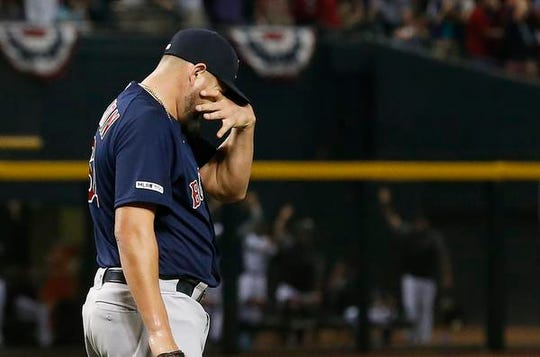 Boston Red Sox pitcher Brian Johnson reacts after giving up a grand slam to Arizona Diamondbacks' Ketel Marte during the sixth inning Friday, April 5, 2019, in Phoenix.