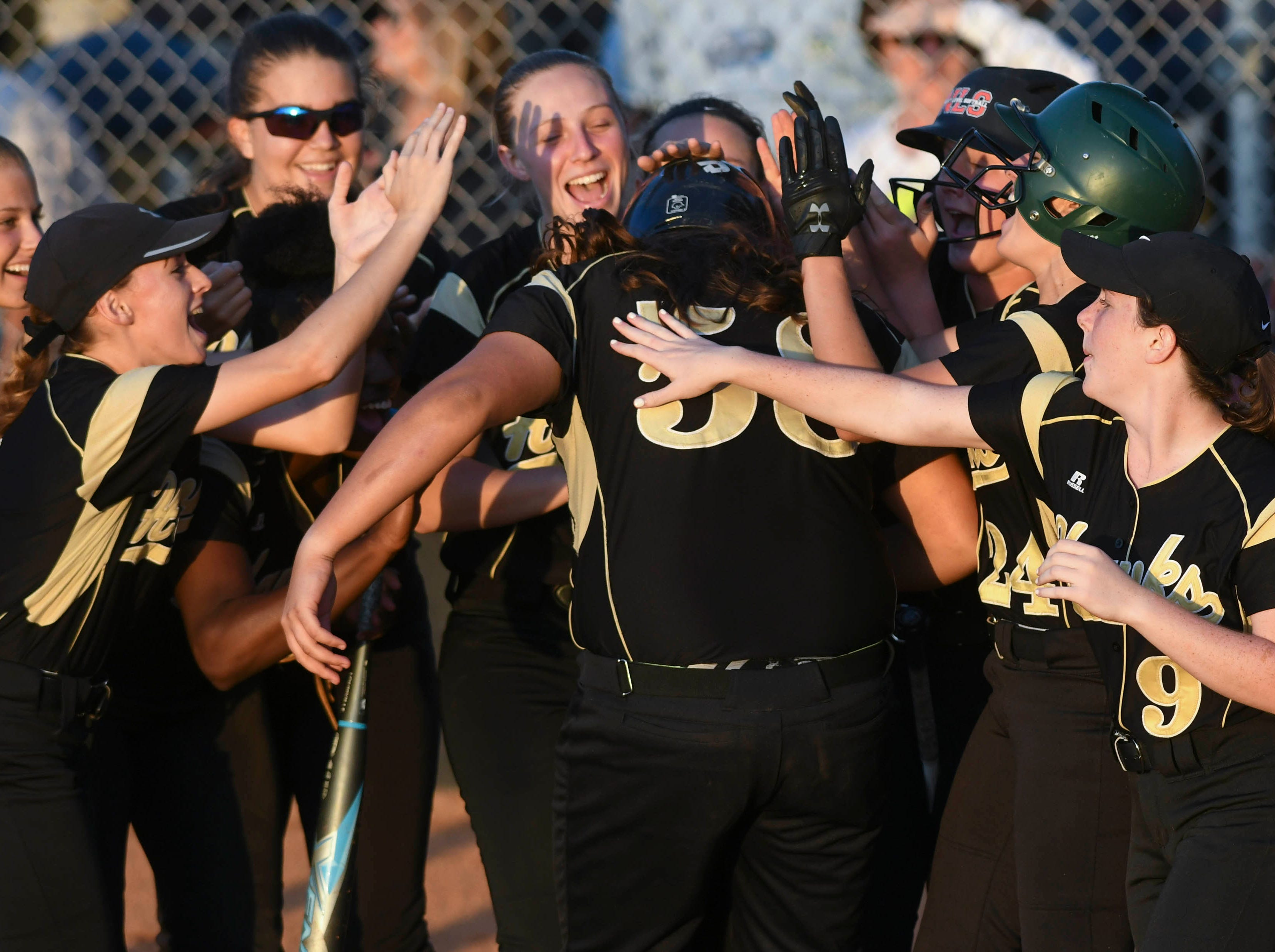 Viera's Morgan Mordas is welcomed by her teammates after hitting a home run in Friday's game against Cocoa.