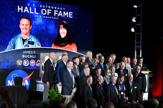 James F. Buchli and Janet Kavandi join the other members of the American Astronaut Hall of Fame for images during Saturday's ceremonies at the Kennedy Space Center Visitor Complex.