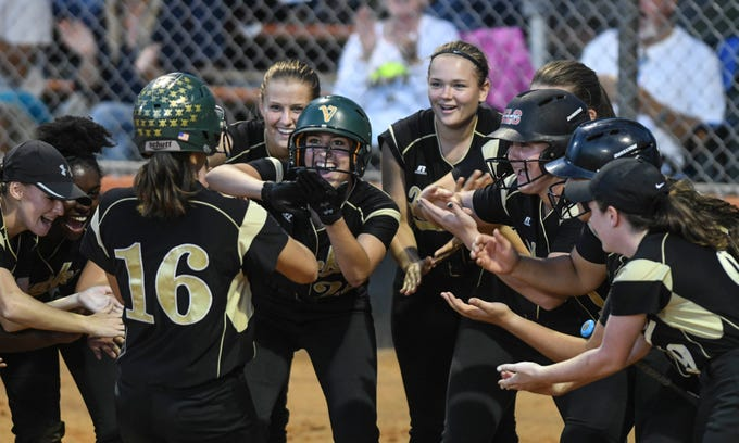 Viera players welcome home teammate Taylor Jensen after her home run in Friday's game against Cocoa.