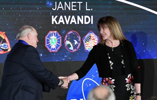 James F. Buchli and Janet L. Kavandi, representatives of the US astronaut Hall of Fame, greet each other at the Kennedy Space Center Visitor Complex on Saturday.
