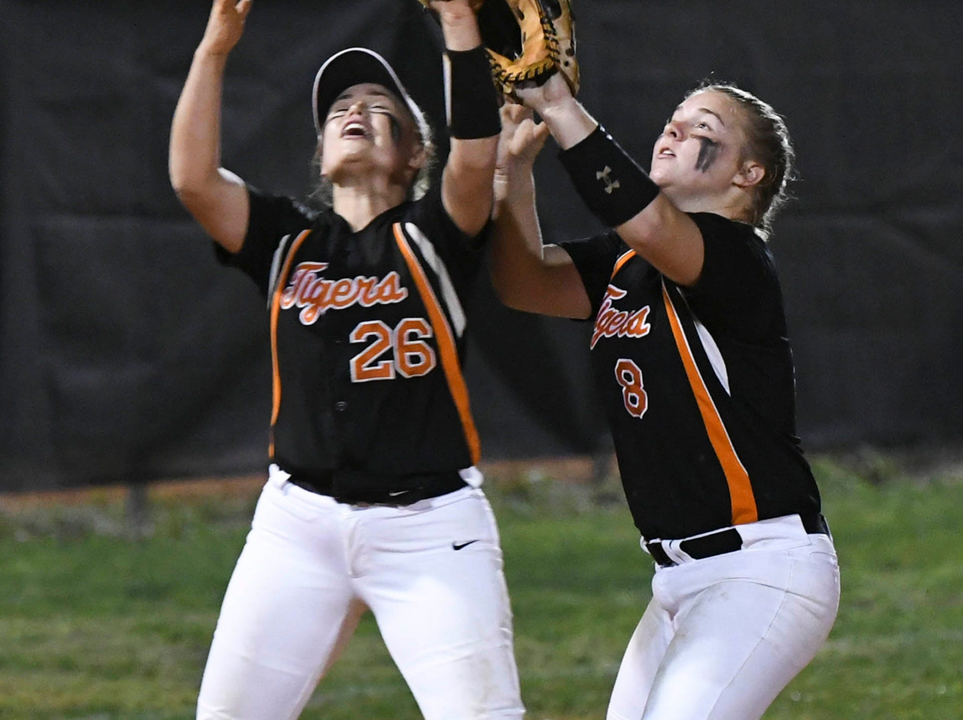 Cocoa's All Clemens and Mackenzie Hoffman go for a fly ball during Friday's game against Cocoa.