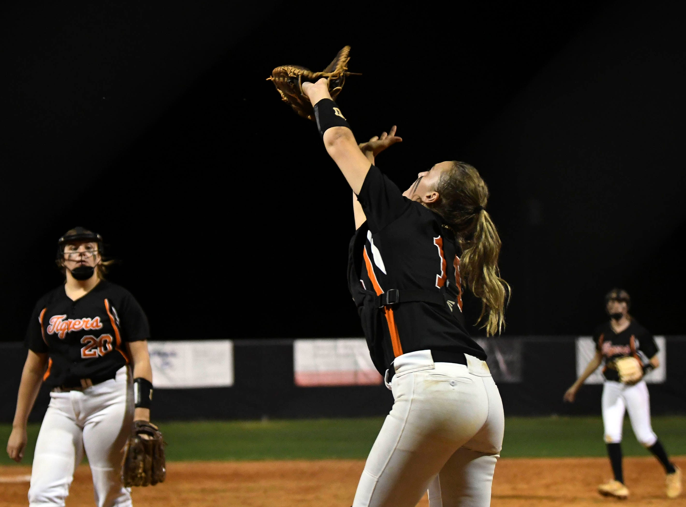 Cocoa catcher Madison Lawson brings down a fly ball during Friday's game against Viera.