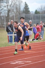 Kalib Griffin, right, and Evan Barker were two of three seniors returning from the state-qualifying 4x100 relay.