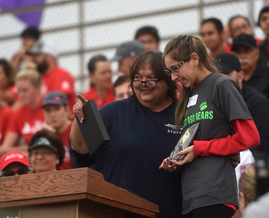 Sara Sanchez, right, receives an award from Special Olympics, Saturday, April 6, 2019, at Hornet Stadium. Sanchez goes to West Oso High School.