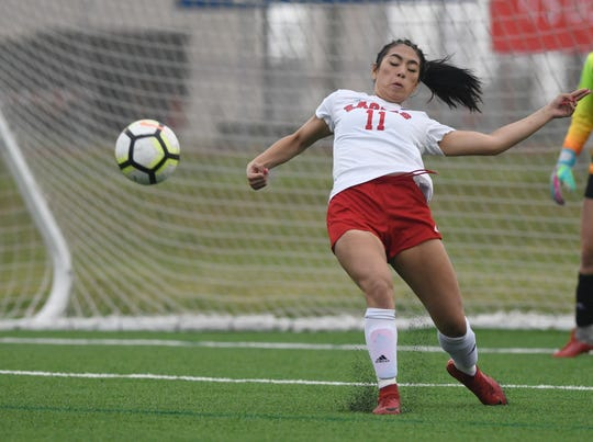 Veterans Memorial's Audrey Medina kicks the ball at the soccer playoff game against Gregory-Portland, Friday, April 5, 2019, at Cabaniss Soccer Field.