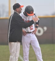 Ryle head coach Pat Roesel talks to Caleb Furnish at third base as Moeller defeated Ryle in 10 innings, 5-2, April 5, 2019 at Ryle HS, Union KY.