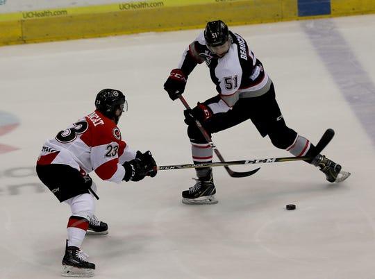 Cyclones defensemen Andrew DeBrincat battles Brampton Beast player David Pacan for the puck during their hockey game, Friday, April 5,2019.