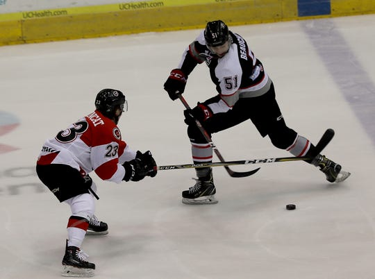 Cyclones defensemen Andrew DeBrincat battles Brampton Beast player David Pacan for the puck during their hockey game, Friday, April 5,2019.