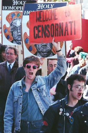 Marchers on Fountain Square protest the obscenity charges filed against the Contemporary Arts Center in 1990 for displaying Robert Mapplethorpe's controversial photographs.