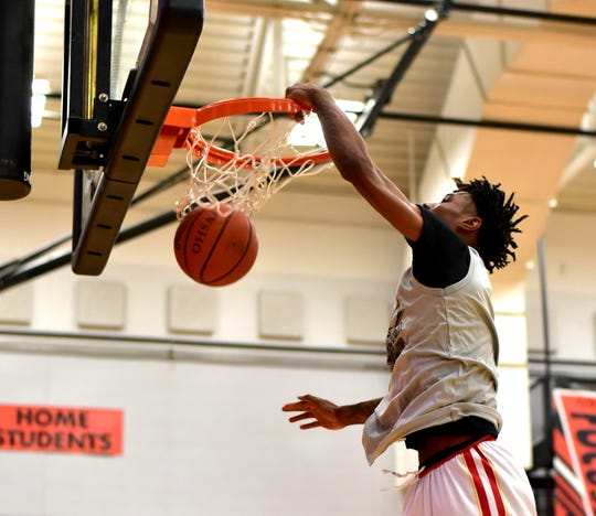 Purcell Marian's A.J. Garrett slams home a dunk shot at the Grey vs. Black game of the 2019 Boys District 16 all-star games at Withrow High School, April 5, 2019.