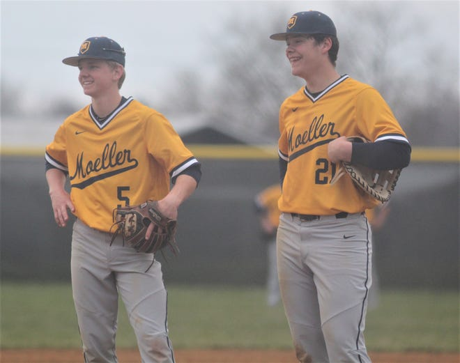 Travis Graves and Michael O'Callaghan of Moeller share a laugh during a break in the action as Moeller defeated Ryle in 10 innings, 5-2, April 5, 2019 at Ryle HS, Union KY.