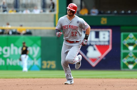 Apr 6, 2019; Pittsburgh, PA, USA;  Cincinnati Reds base runner Kyle Farmer (52) circles the bases after hitting a third inning home run against the Pittsburgh Pirates at PNC Park. Mandatory Credit: Philip G. Pavely-USA TODAY Sports