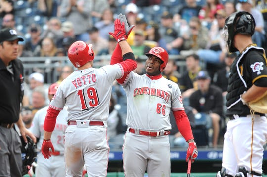 Apr 6, 2019; Pittsburgh, PA, USA;  Cincinnati Reds batter Joey Votto (19) celebrates with Reds Yasiel Puig (66) after hitting a home run in the eighth inning against the Pittsburgh Pirates at PNC Park. Mandatory Credit: Philip G. Pavely-USA TODAY Sports