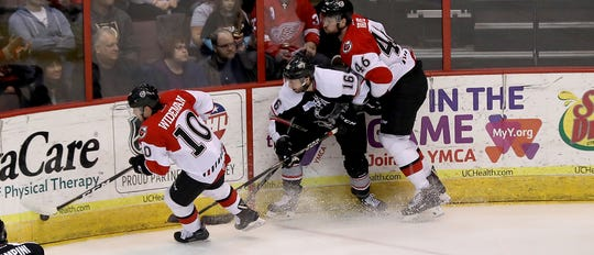 Cyclones forward Alex Wideman (10) and teammate Justin Vaive battle   Brampton Beast player Nathan Todd for the puck during their hockey game, Friday, April 5, 2019.