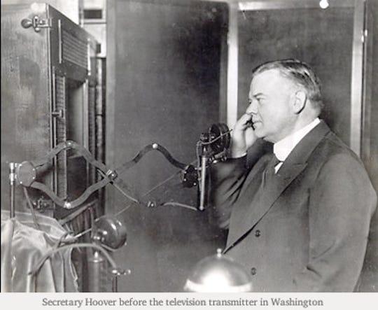 Commerce Secretary Herbert Hoover before the television transmitter in Washington, D.C., in 1927.