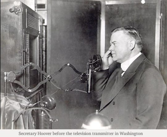 Commerce Secretary Herbert Hoover before the television transmitter in Washington, D.C., in 1927.