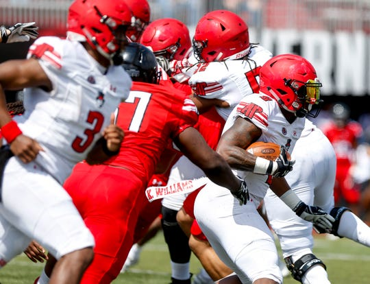 Kentel Williams (5) breaks free from defensive players while running the ball during the Austin Peay spring football game at Fortera Stadium in Clarksville, Tenn., on Saturday, April 6, 2019.