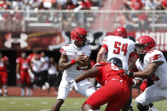 Austin Peay's JaVaughn Craig drops back to pass the ball against the Govs' defense during the Red-White spring game Saturday, April 6, 2019.