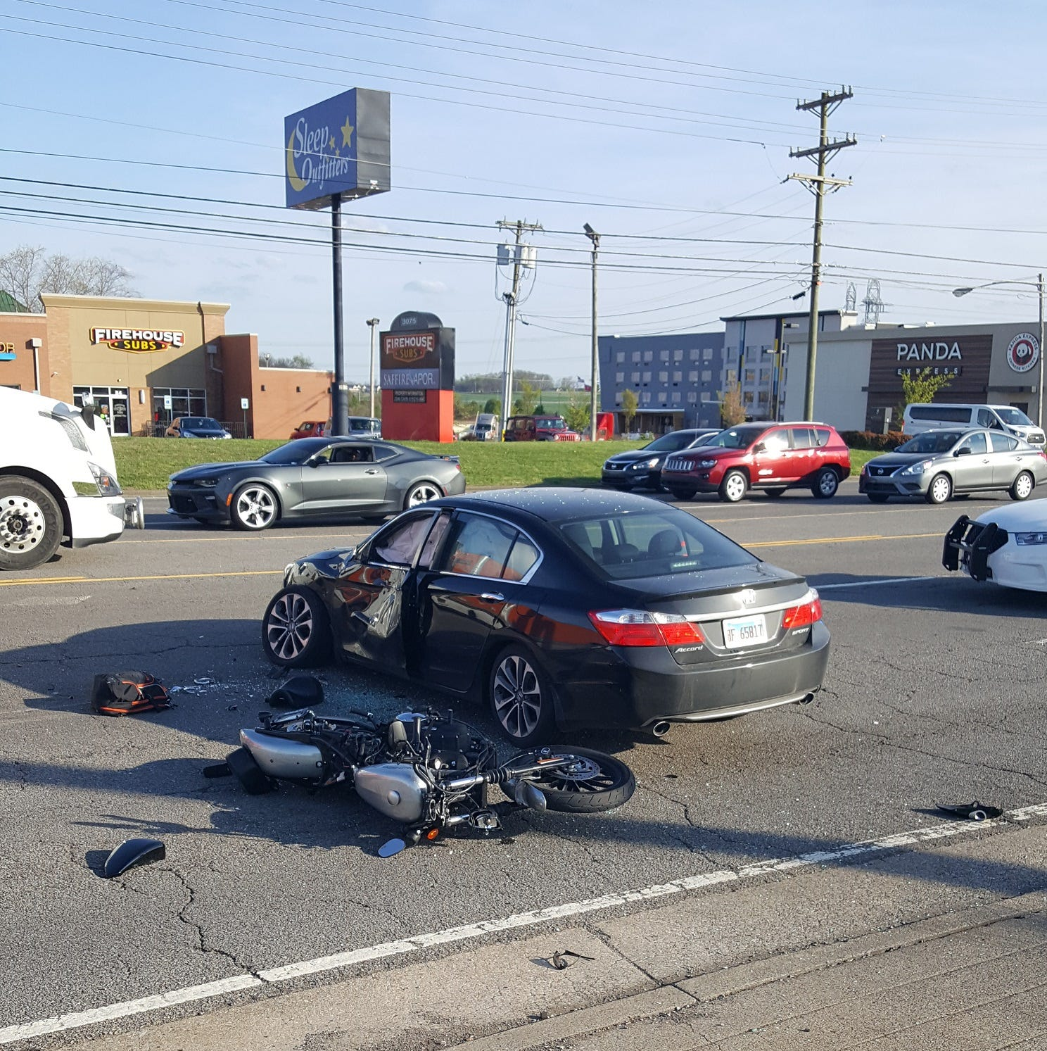1 hurt in motorcycle and car crash on Wilma Rudolph Boulevard