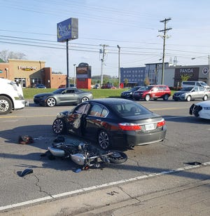 A car crashed with a motorcycle on Wilma Rudolph Boulevard Saturday evening, April 6, 2019.
