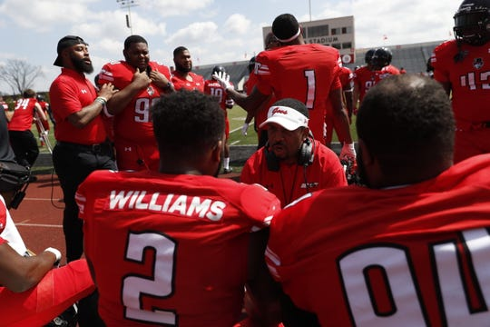 Austin Peay's defense talk strategy during a break in action in the Govs' Red-White spring game Saturday, April 6, 2019.