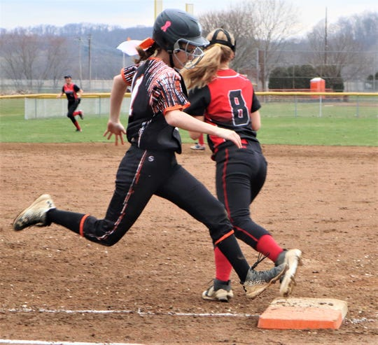 Ridgewood's Shelby Harding tries to beat out a ground ball in Friday's 10-8 loss to Tusky Valley.