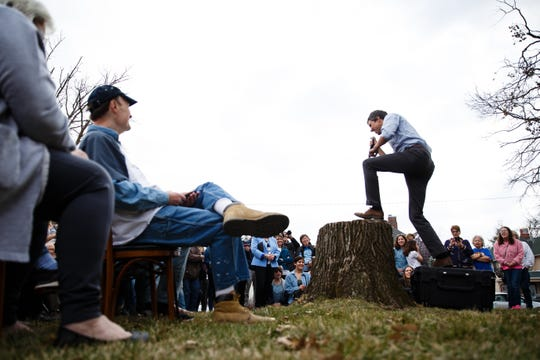 2020 Democratic presidential candidate and former Texas Representative Beto O'Rourke climbs onto a stump to give his speech in Marshalltown at the Mowry Irvine Mansion during a swing though Iowa on Friday, April 5, 2019, in Marshalltown.