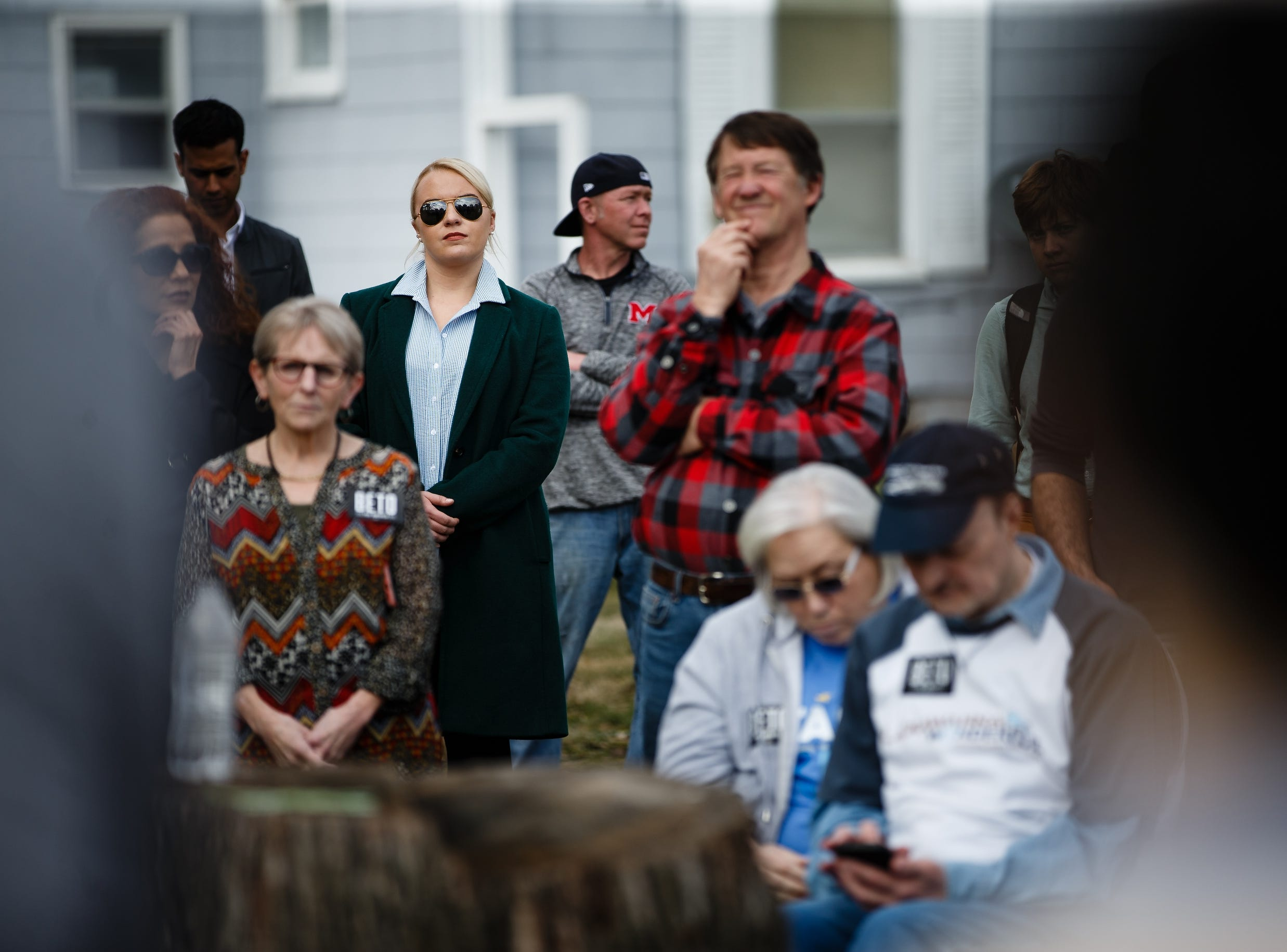 Donning sunglass, campaign staffers watch as 2020 Democratic presidential candidate and former Texas Representative Beto O'Rourke speaks in Marshalltown during a swing though Iowa on Friday, April 5, 2019, in Marshalltown.
