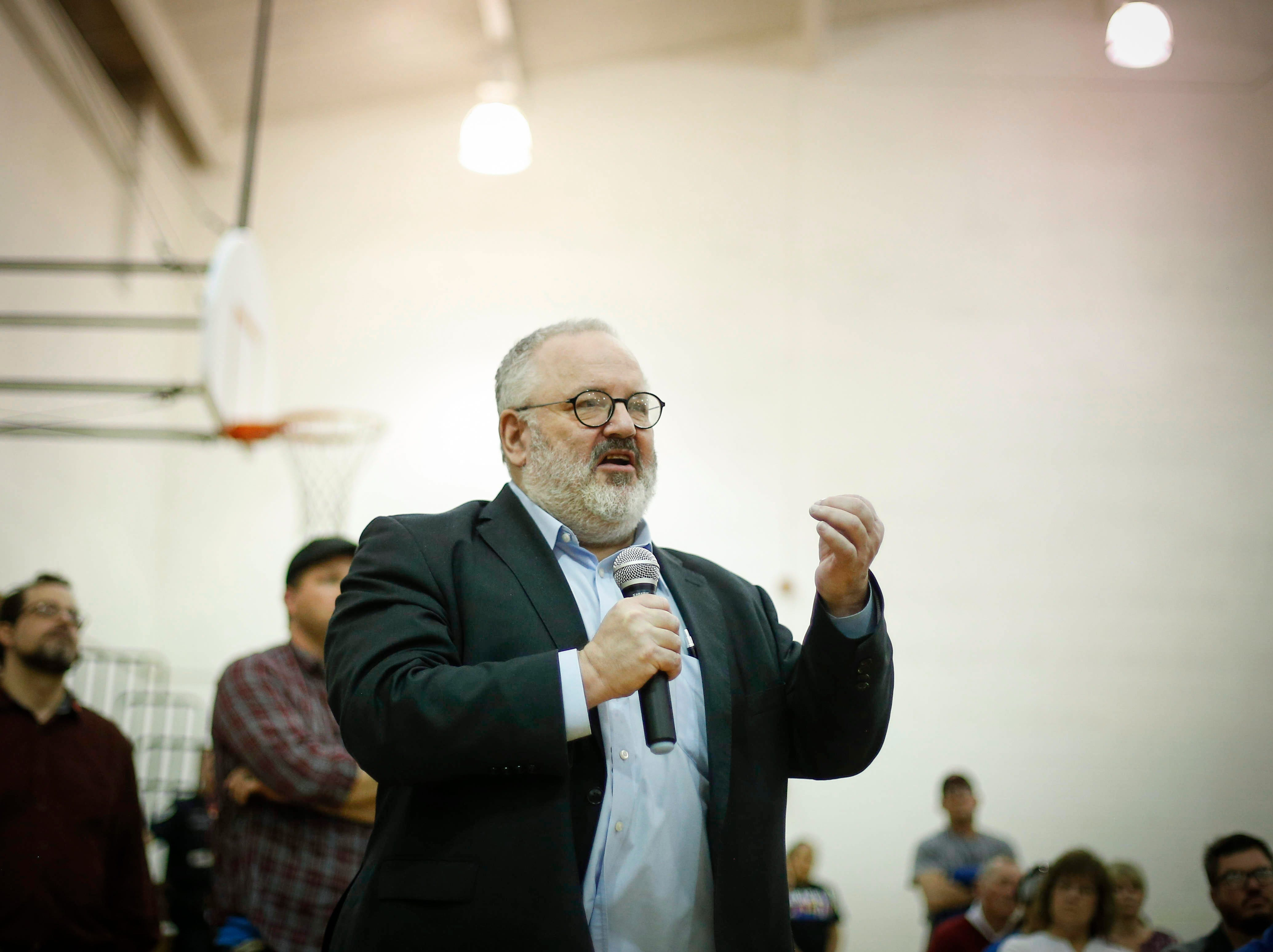 Marc Daniels, originally from Des Moines, asks U.S. Sen. Bernie Sanders a question during a town hall meeting at West Middle School in Muscatine on Saturday, April 6, 2019.