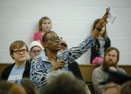 Ohio Sen. Nina Turner fires up the crowd prior to the arrival of U.S. Sen. Bernie Sanders during a town hall style meeting at West Middle School in Muscatine on Saturday, April 6, 2019.